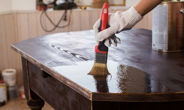 Painting over stained wood